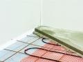 Isolation des planchers bas : pose du panneau Eps.sol Plus