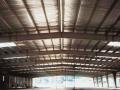 Isolation toiture et bardages métalliques : pose de Feutre Tendu Alu ISOVER