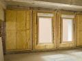 Isolation des murs : pose du panneau en laine de verre GR 32