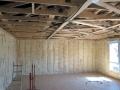 Maison à ossature bois : pose de l'isolant Isomob 32R