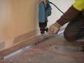 Isolation thermique des murs par l'intérieur : pose de la lisse Clip'Optima