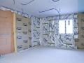 Pose de la membrane d'étanchéité à l'air Vario Xtra en isolation des murs par l'intérieur
