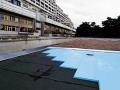 Pose de Roomate SL-A : isolation des bâtiments maçonnés