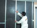 Isolation des murs par l'intérieur : pose de Soniroll Confort