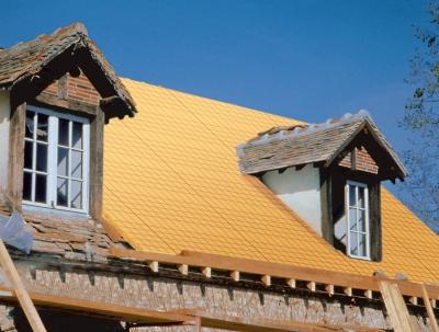 Isolation toitures par l'extérieur système Sarking : pose du panneau Luro