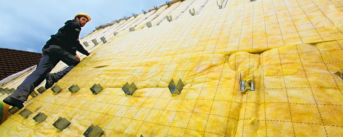 Maîtriser l'isolation thermique et acoustique des toitures par l'extérieur : mise en œuvre et construction du devis