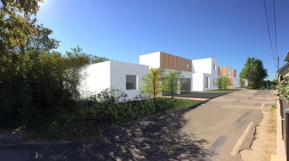 Chaque maison bénéfice d'une finition extérieure associant, selon la modénature, enduit blanc cassé et bardage.