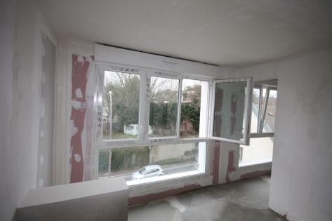 Isolation thermique en logements collectifs : Pose des fenêtres et du doublage intérieur