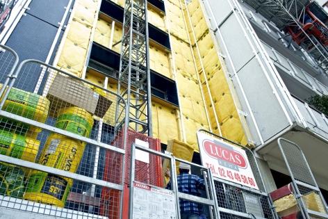 Rénovation BBC : Pose laine de verre tour super montparnasse